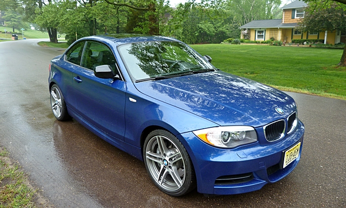 BMW 1-Series Photos: BMW 135is front quarter wet road