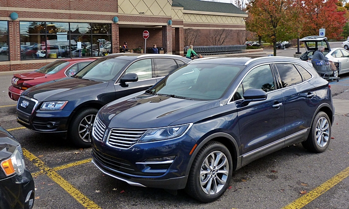 Lincoln MKC Photos: Lincoln MKC and Audi Q5 front quarter
