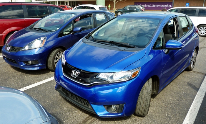 Honda Fit Photos: Third and second gen Honda Fit front quarter view