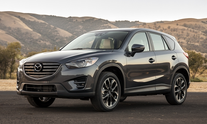 Hyundai Tucson Photos: Mazda CX-5 front quarter view
