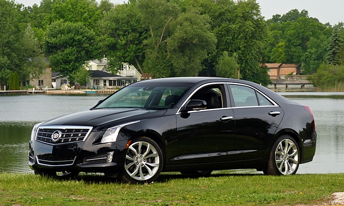 Cadillac ATS Photos: 2014 ATS sedan front quarter view lake