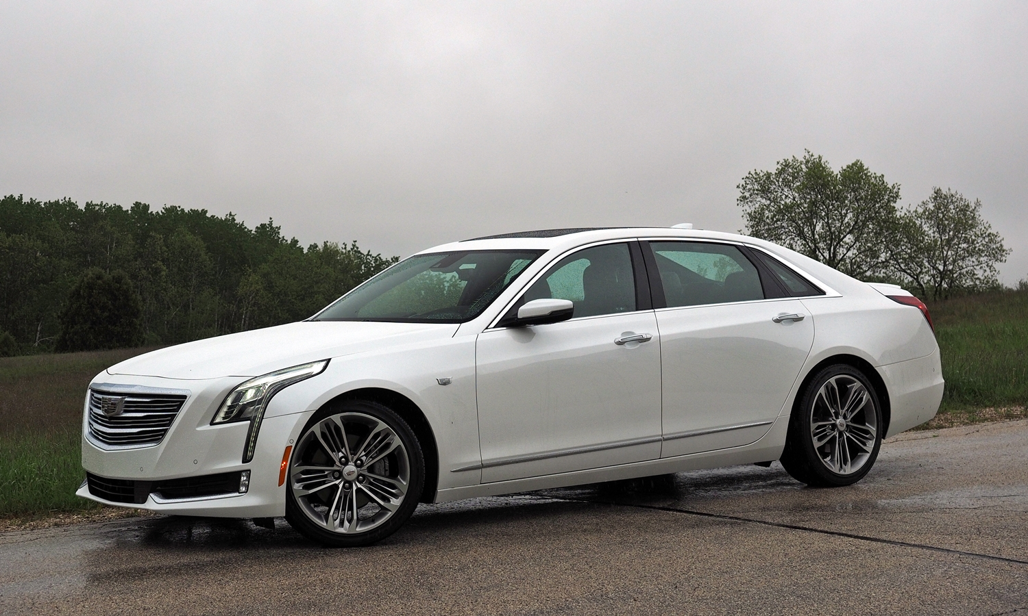 Genesis G90 Photos: Cadillac CT6 front quarter view